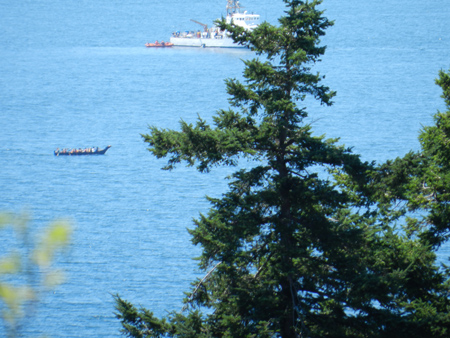 Canoes with Coast Guard near by