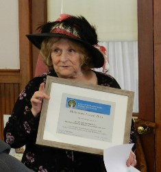 Gail Chism of the Lowell Civic Association accept the award for the Publication 150 Years of Lowell History which she wrote with co-author Karen Redfield.